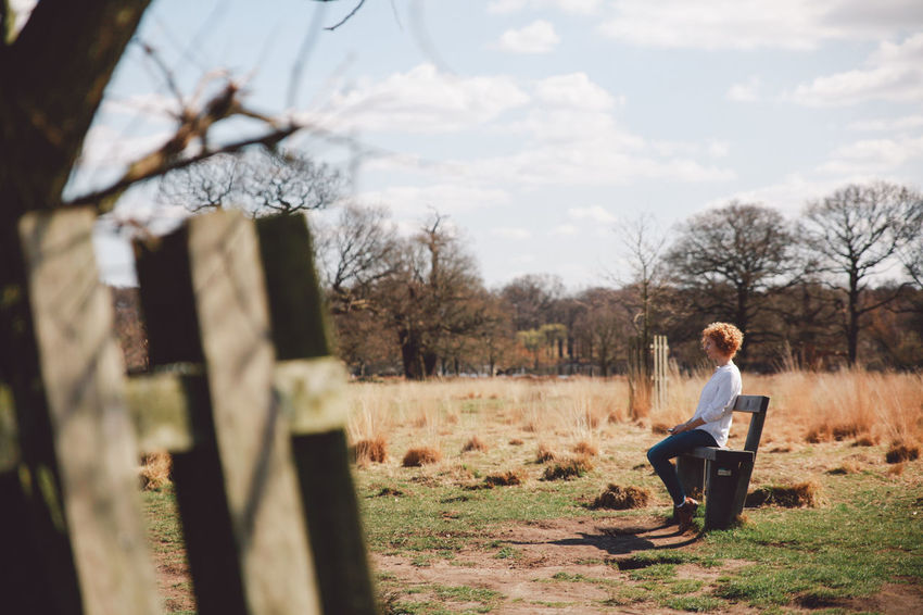 Bare Tree Bench Blonde Blue Jeans Casual Clothing Curly Hair Day Full Length Girl Hat Landscape Leisure Activity Lifestyles London Nature Outdoors Portrait Richmond Park, London Sitting Spring Sunny Tree Tree Trunk White Shirt Original Experiences Breathing Space