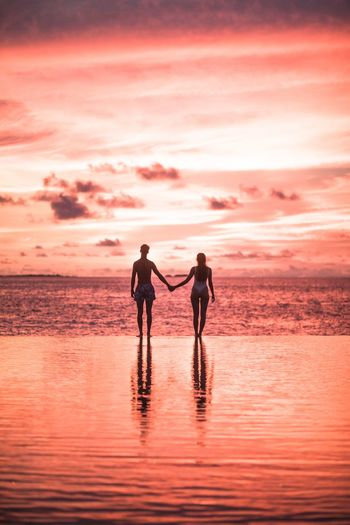 Sunset romance in Maldives Sea Beauty In Nature Cloud - Sky Full Length Silhouette Orange Color Men Leisure Activity Beach Scenics - Nature People Positive Emotion Standing Land