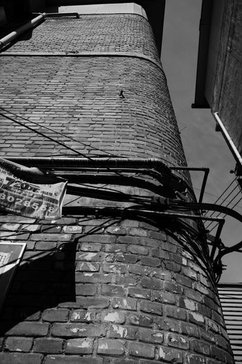Blackandwhite Architecture Built Structure Building Exterior Low Angle View No People Building The Architect - 2018 EyeEm Awards Day City Brick Brick Wall Wall Sunlight