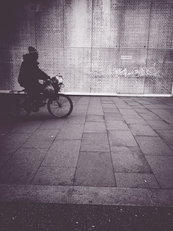 (cyclically) Andrographer Blackandwhite Londononly Peoplecyclingpastwalls
