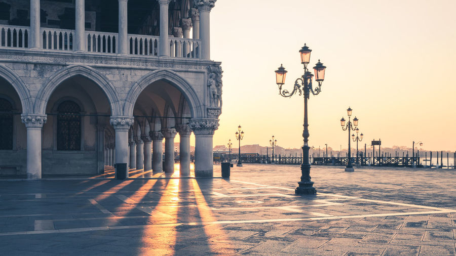 Lamp posts at doges palace during sunset