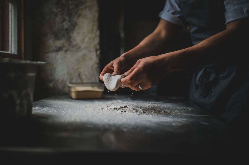 Pizza Dough Chef Cigarette  Domestic Room Dough Food And Drink Hand Holding Human Body Part Human Hand Indoors  Lifestyles Making Men Midsection Occupation One Person Pizza Pizza Making Preparation  Preparing Food Real People Selective Focus