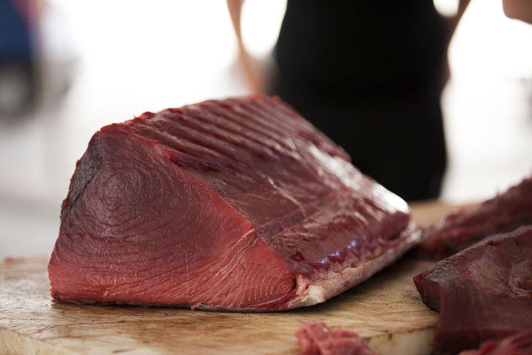 Close-up of tuna fish on cutting board