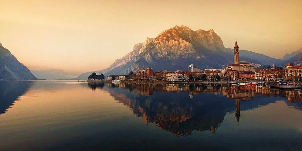 Reflection of city with mountain in lake