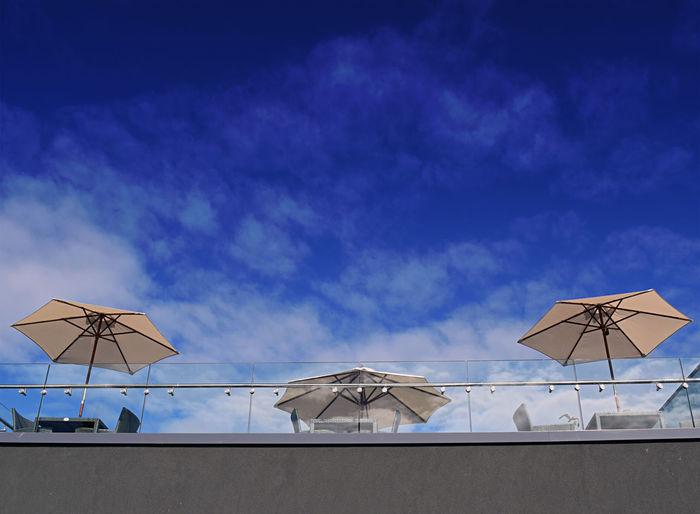 Parasols against blue sky