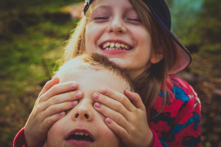 Close-Up Of Playful Siblings