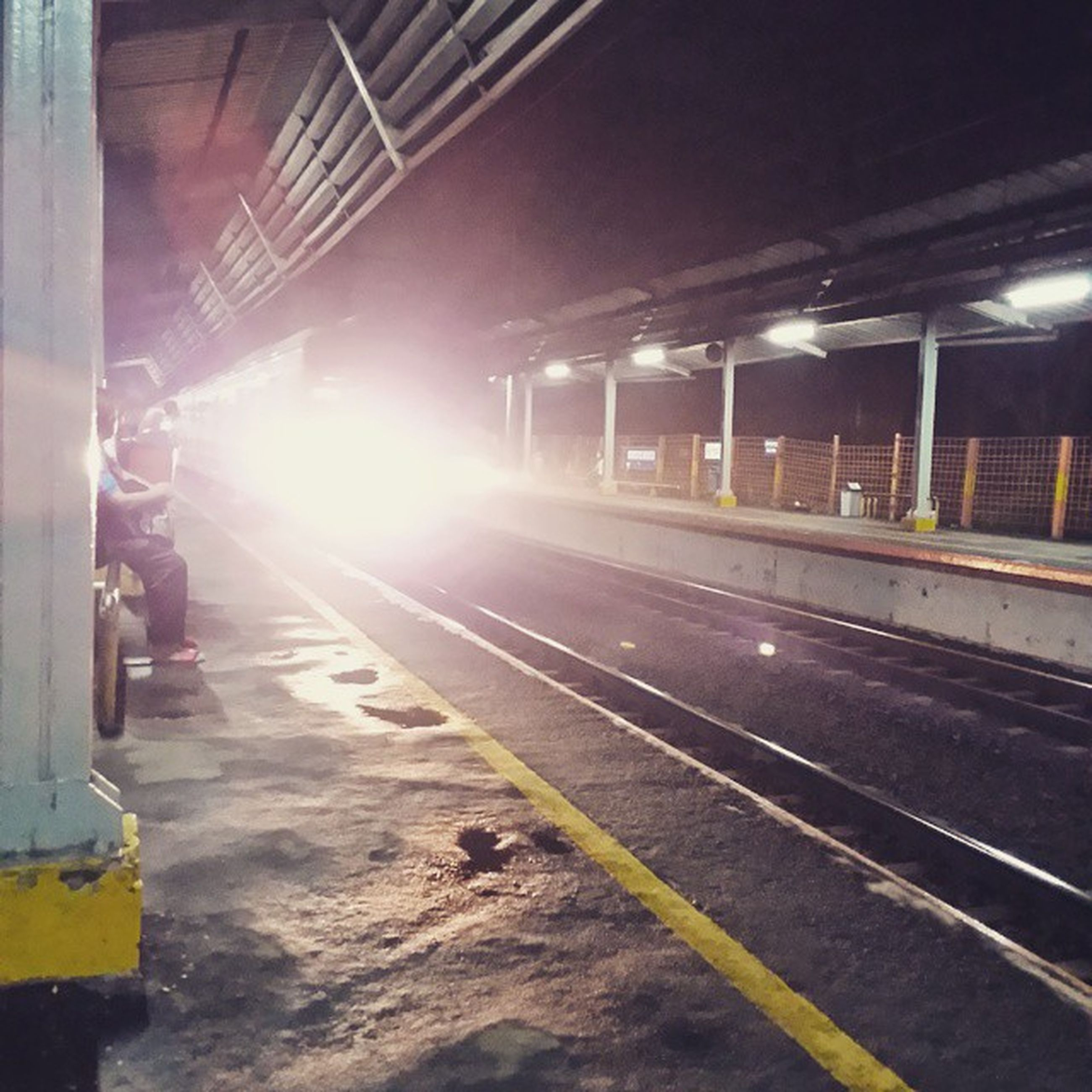 transportation, railroad track, public transportation, railroad station platform, mode of transport, motion, rail transportation, railroad station, blurred motion, illuminated, on the move, travel, speed, road, long exposure, built structure, train - vehicle, city life
