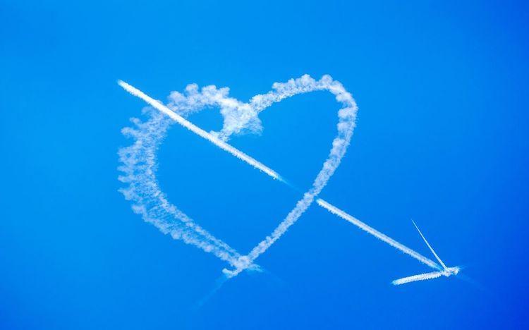 True Love Skywriting True Love Cupid Arrow Blue Sky Skywriting Romantic White Heart Love