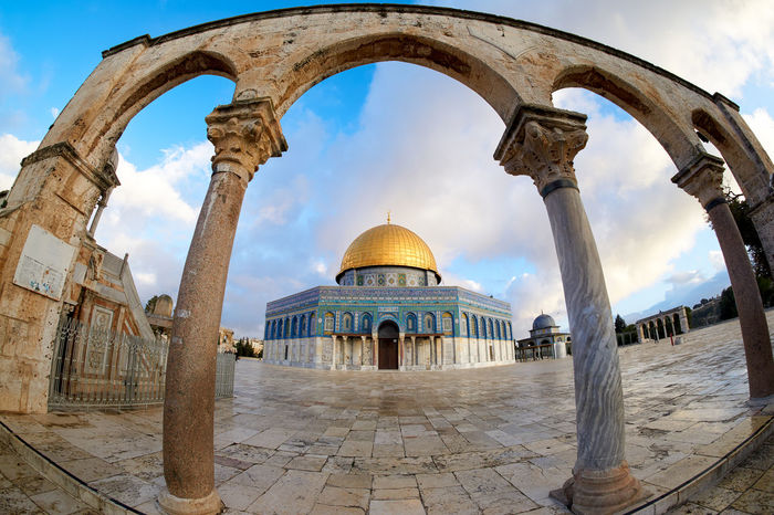 A fish eye view of Dome of the Rock in Masjidil Aqsa, Jerusalem, Palestine, framed by pillars Ancient Architecture City Gold Heritage Historical History Holiday Mosque Muslim Outdoors Place Of Worship Prayer Travel Destinations