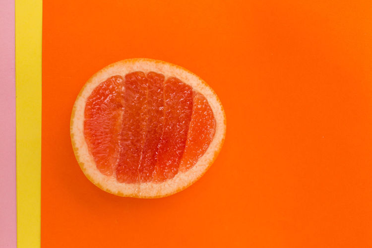 Food And Drink Orange Color Food Healthy Eating Wellbeing Fruit Studio Shot Freshness Colored Background Indoors  Close-up Cross Section Still Life Citrus Fruit Juicy No People Copy Space SLICE Orange Background Cut Out Ripe Orange