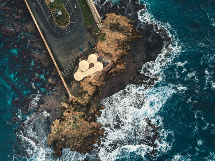 High Angle View Water Sea No People Rock Nature Solid Day Rock - Object Outdoors Waterfront Motion Beauty In Nature Tranquility White Color Land Sport Scenics - Nature Waves, Ocean, Nature Weather Ocean Beauty In Nature Blue Australia Drone