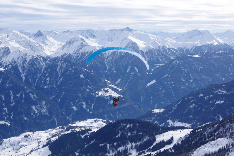 Aerial view of people skiing on snowcapped mountain