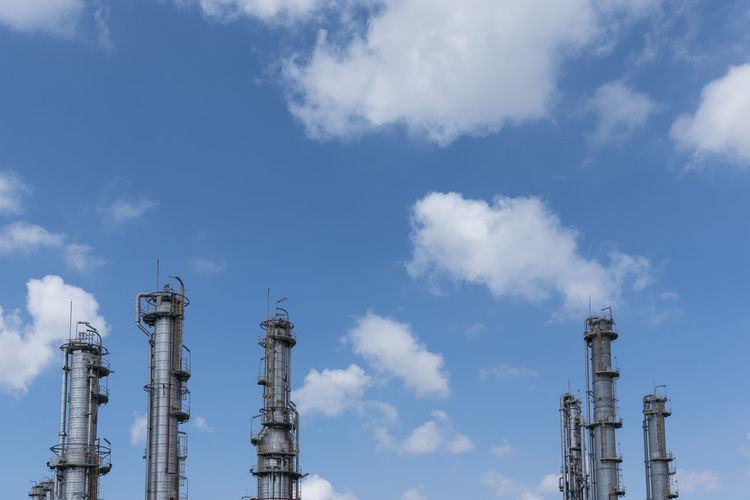 Low Angle View Of Industrial Buildings Against Sky