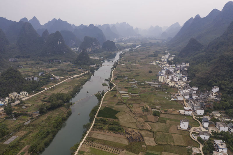 Aerial view of river and mountains against sky