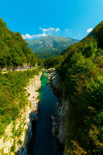soca river in slovenia EyeEm Best Shots EyeEmNewHere Slovenia Soca River Beauty In Nature Day Environment Flowing Water Green Color Land Landscape Mountain Mountain Peak Mountain Range Nature No People Non-urban Scene Outdoors Plant River Scenics - Nature Sky Tranquil Scene Tranquility Water