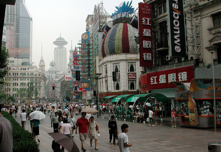 Pedestrian mall in Shanghai, China. Architecture Building Exterior China City Destination Malls Pedestrians Retail  Shanghai Shopping Smog Streets Tourism Tourists Umbrellas Urban Walking