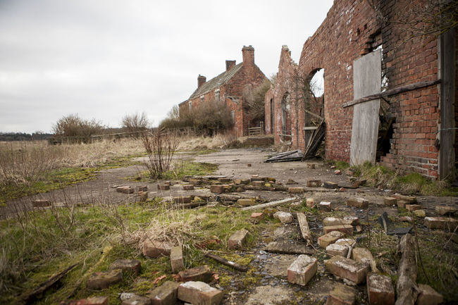An old farmhouse building Crash Eye For Detail Home Abandoned Accident Another Brick In The Wall Architecture Bad Condition Bricks Broken Wall Building Exterior Built Structure Damaged Delapidated Destruction Landscape Mortgage No People Old Ruin Outdoors Potential  Property Renovation Propertydevelopment Rural Scene
