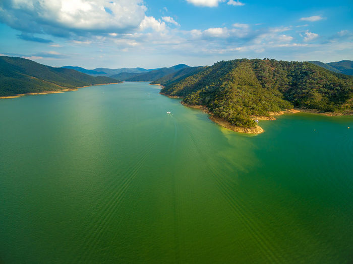 Aerial view of Lake Eildon coastline hills at sunset. Melbourne, Australia Australia Australian Australian Landscape Drone  Nature Scenic View Aerial Aerial View Beauty In Nature Cloud - Sky Dam Day Drone Photography Eildon Lake Lake Eildon Landscape Mountain Mountain Range Nature No People Outdoors Park Scenics Sky Tranquil Scene Tranquility Water Waterfront