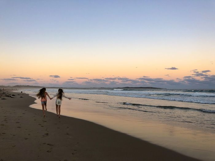 Identical twin girls skipping along Cronulla Beach at sunset 👯♀️💓 Having Fun Fun Young Girl Australia Beach Sunset Skipping Long Hair Twins IDENTICAL TWINS Girl Power Girls Beach Sky Land Sea Water Sunset Real People Beauty In Nature Togetherness Leisure Activity Lifestyles Scenics - Nature Two People Bonding People Horizon Horizon Over Water Nature My Best Photo