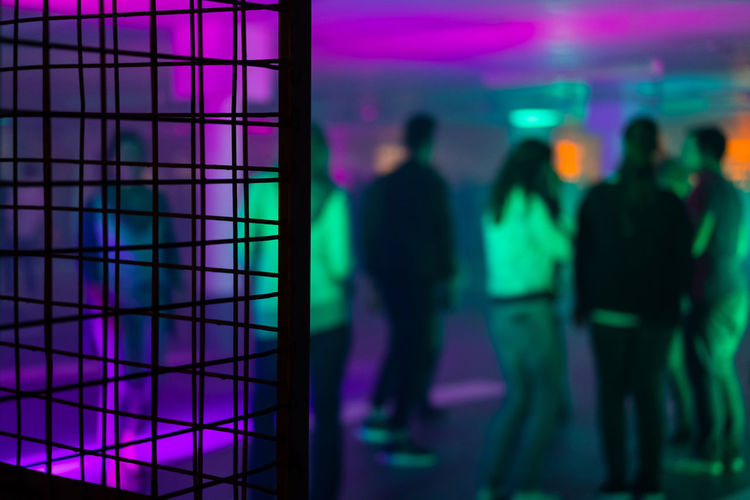 Group of unrecognizable young people dancing during a party in an improvised warehouse with boxes in the foreground Clubbing Dancing EyeEmNewHere Lights Boxes Disco Improvised Party People Real People Warehouse