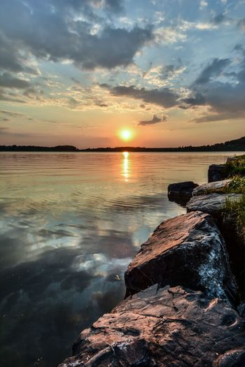 Sunset Sky Beauty In Nature Scenics Water Sun Cloud - Sky Horizon Over Water Rock - Object Reflection Tranquility Tranquil Scene Dramatic Sky Idyllic Outdoors Sunlight No People Lake