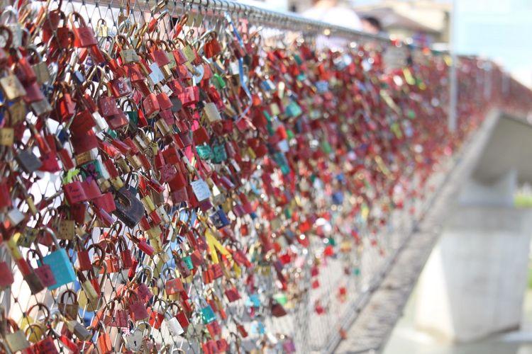 Locks on a bridge Europe Lockbridge  Love Lock Multi Colored