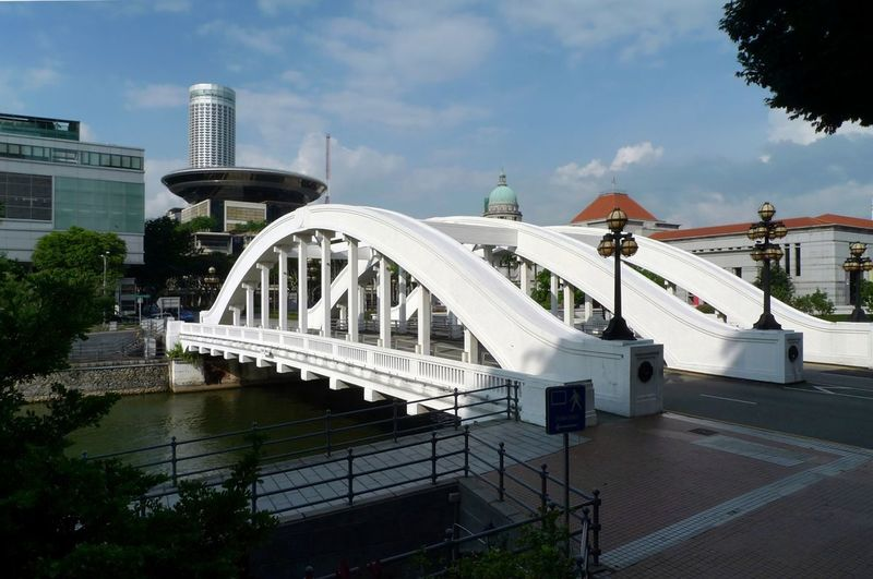 The Singapore River, Singapore, by the Elgin Bridge. Elgin Bridge Singapore Singapore River Architecture Bridge Bridge - Man Made Structure Building Exterior Built Structure Cloud - Sky Day Nature No People Outdoors Sky Travel Destinations Tree Water