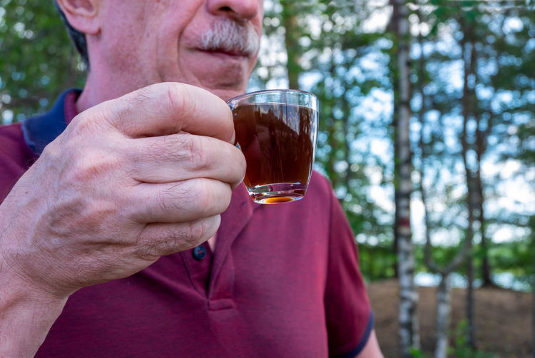 Close-up of man drinking glass