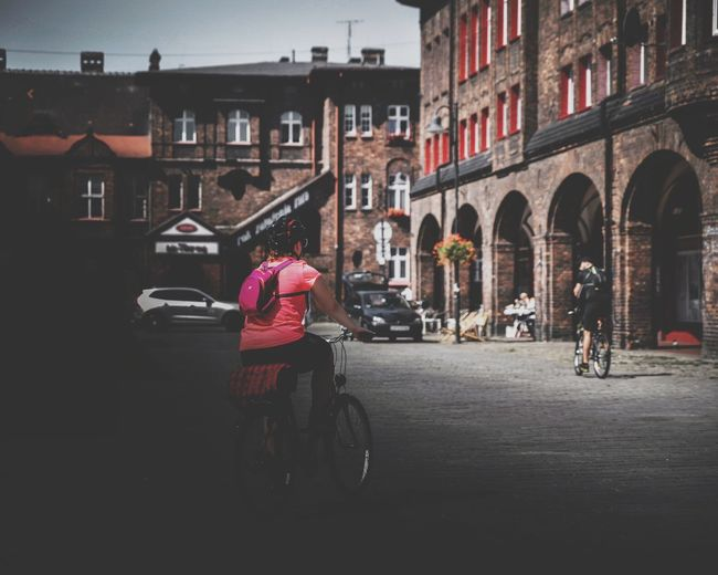 Architecture Building Exterior Bicycle Built Structure Transportation City Men Outdoors Day Adult People Adults Only Nikiszowiec Katowice EyeEm Best Edits EyeEm Selects The Week On Eyem EyeEm Gallery Streetphotography Women Bicycles