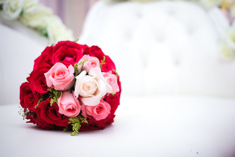 Close-Up Of Red Rose Bouquet On Table