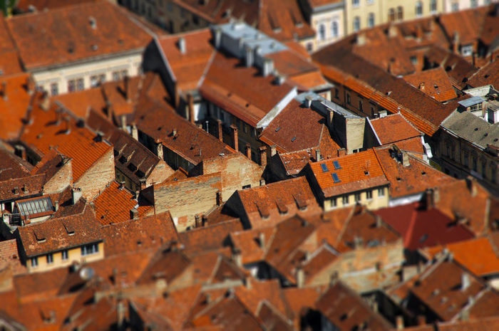 Aerial view of Brasov city in Transylvania, Romania. Tilt shift lens effect Brasov Romania City Cityscape Drone  Houses Kronstadt Saxon Streets Tilt-shift Transylvania Above View Architecture Building Exterior City Above Day Drone Photography Dronephotography Droneshot Dronestagram Europe Medieval Architecture Outdoors Roof Town Urban