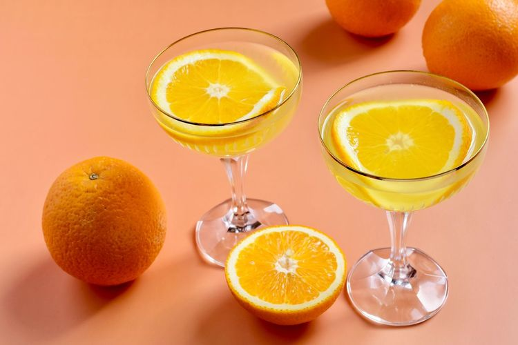 Various fruits on glass of orange juice