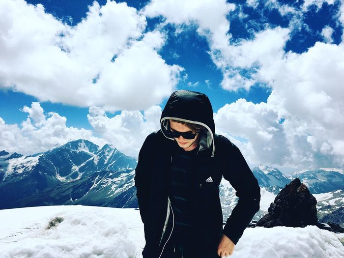 Snow Season  Winter Cold Temperature Mountain Leisure Activity Weather Cloud - Sky Beauty In Nature Scenics Sky Tourist Tranquil Scene Tourism Lifestyles Non-urban Scene Nature Mountain Range Warm Clothing Standing
