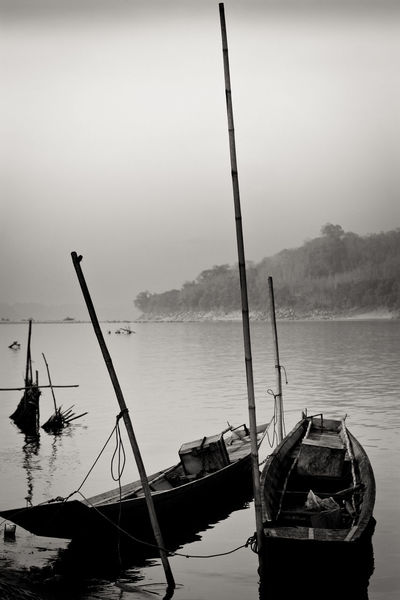 Boat on Mekong river Beauty In Nature Black And White Boa Boat Calm Day Idyllic Laos Mast Mode Of Transport Mountain Nature Nautical Vessel No People Non-urban Scene Outdoors Remote Rippled Sailboat Sailing Scenics Tranquil Scene Tranquility Transportation Water