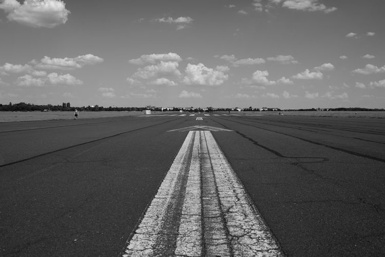 Tempelhofer Feld Nikon DSLR Black & White Blackandwhite 35mm Full Frame Berlin Photography Berlin Runway Airport Tempelhofer Feld Tempelhof Tempelhof Airport Sky Sign Symbol Cloud - Sky Transportation Direction Marking The Way Forward Day Diminishing Perspective Asphalt City Arrow Symbol No People Nature Outdoors Dividing Line