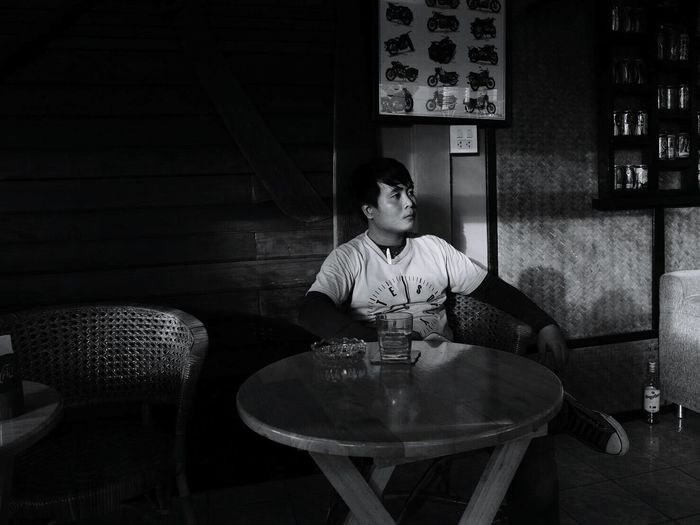 Young Man Sitting In Restaurant