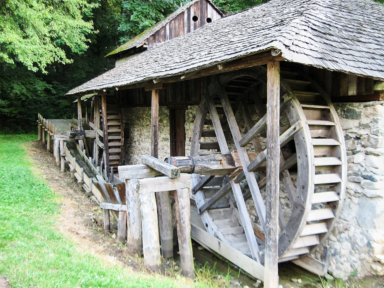 wood - material, built structure, architecture, outdoors, water wheel, day, watermill, field, no people, building exterior, rural scene, tree, grass, nature