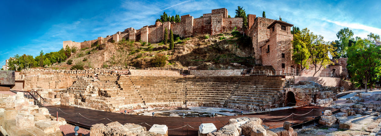 Panoramic view of Roman Theatre in Malaga. Andalusia, Spain Alcazaba De Malaga Andalucía Gibralfaro Castle Malaga Panorama Panoramic SPAIN UNESCO World Heritage Site Amphitheatre Ancient Architecture Costa Del Sol Defence Defensive Europe Fortification Fortress History Landmark Monument No People Old Ruin Outdoors Palace Roman Theatre Sunny Day
