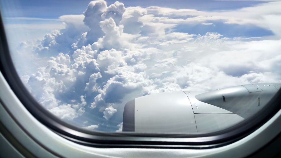 Airplane Over Land Air Vehicle Airplane Beauty In Nature Cloud - Sky Cloudscape Day Engine Flying Jet Engine Mid-air Mode Of Transportation Motion Nature No People Outdoors Sky Transparent Transportation Travel Vehicle Interior Window
