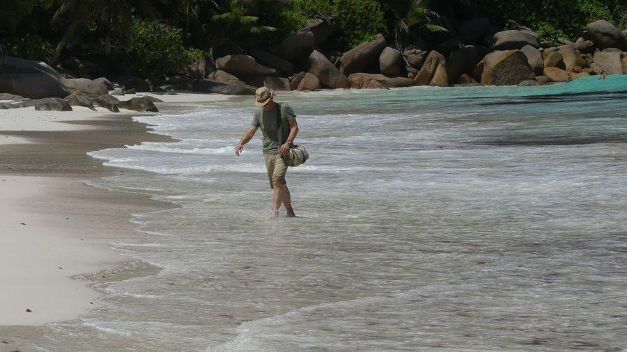 Man walking on shore at beach