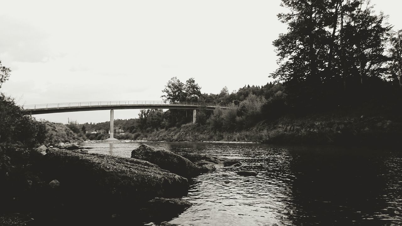 bridge - man made structure, connection, river, water, tree, transportation, built structure, no people, nature, architecture, sky, day, outdoors, motion, bridge, clear sky