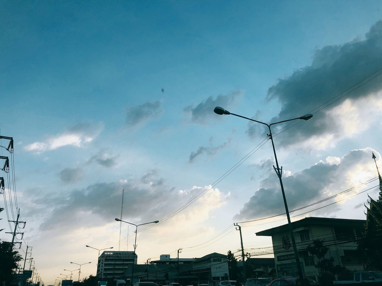 sky, cloud - sky, architecture, built structure, building exterior, low angle view, machinery, nature, no people, building, crane - construction machinery, construction industry, silhouette, city, street, street light, construction site, outdoors, industry, residential district, construction equipment