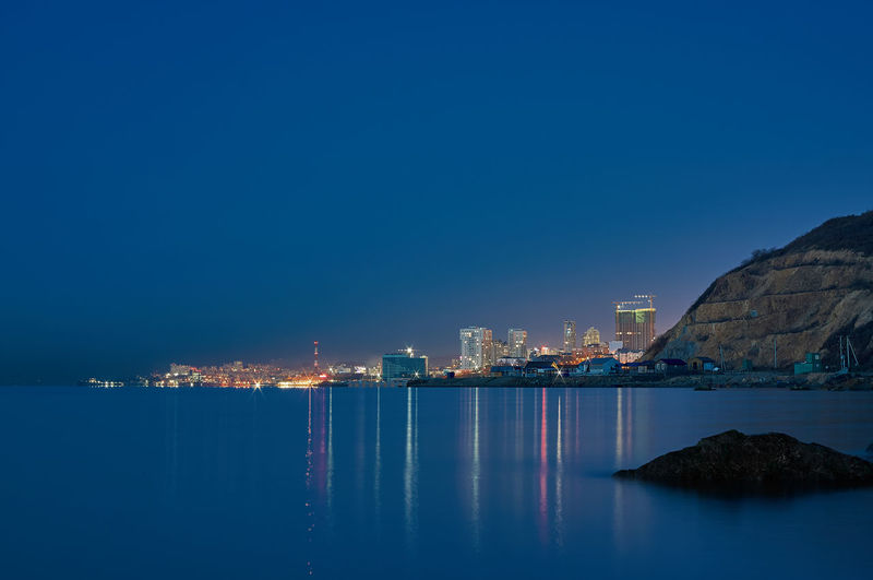 Night city. View from the Amur bay. Vladivostok. Japanese Sea Reflection Lightning Night Amur Bay Vladivostok Evening Long Exposure City Cityscape Water Illuminated Sea Clear Sky Blue Skyscraper Seascape Coast Horizon Over Water Calm Shore Tide Ocean