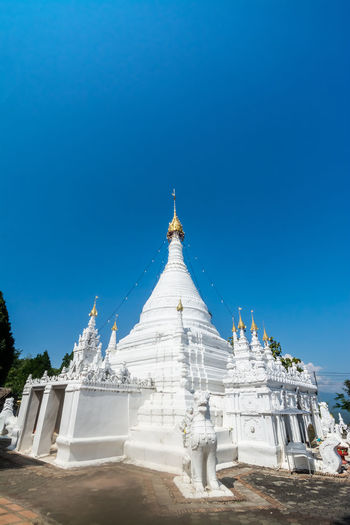 View of temple against clear blue sky