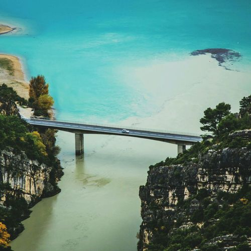 Bridge over sea against sky