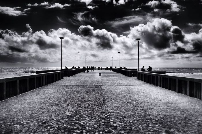 """""""Sii certo che ovunque io stia vagando,il mio cuore è a casa accanto al tuo."""" (E.Brontë) Clouds Clouds And Sky EyeEm Gallery Getting Inspired EyeEmBestPics Mllml Altro, Oltre Playing With Thoughts EyeEm Best Shots Eye4photography  Canon Blackandwhite Bw_collection Black And White EyeEm Bnw Sea Pier"""