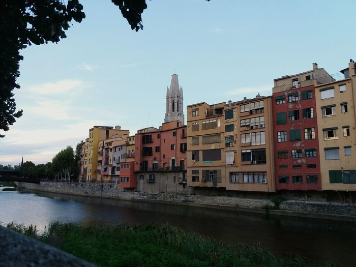 Reflection Water No People Architecture Outdoors Building Exterior Cityscape City La Meva Ciutat My City River Houses Cases Del Riu Sant Felix La Ciutat Dels Quatre Rius Onyar Riu River Girona Travel Destinations Catalonia Church Architecture Church Urban Skyline CataloniaExperience Sunset