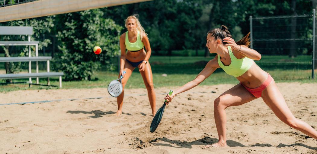 Beach tennis player hits the ball