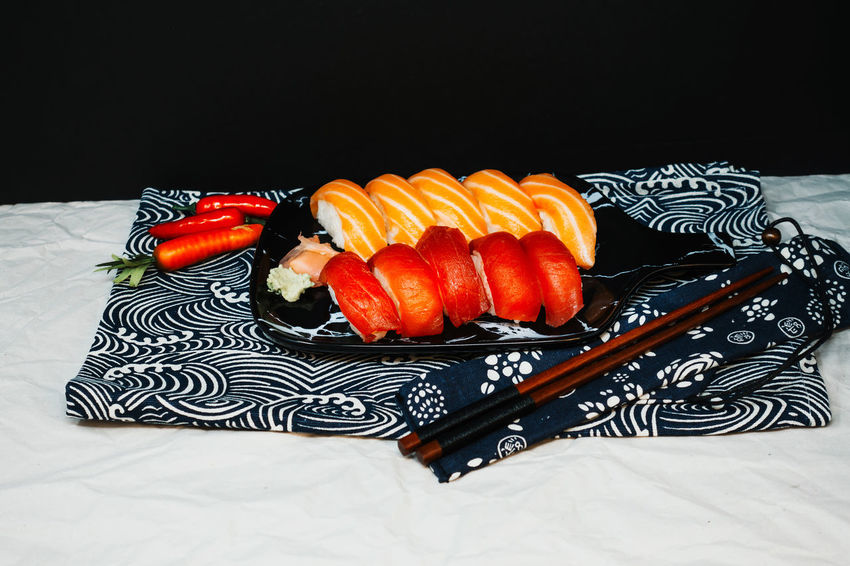Food And Drink Food Indoors  Still Life Freshness Studio Shot Black Background No People Healthy Eating Close-up Table Pattern Fruit Wellbeing Ready-to-eat High Angle View Orange Color Indulgence Tablecloth Plate Floral Pattern Temptation Japanese Food Tray