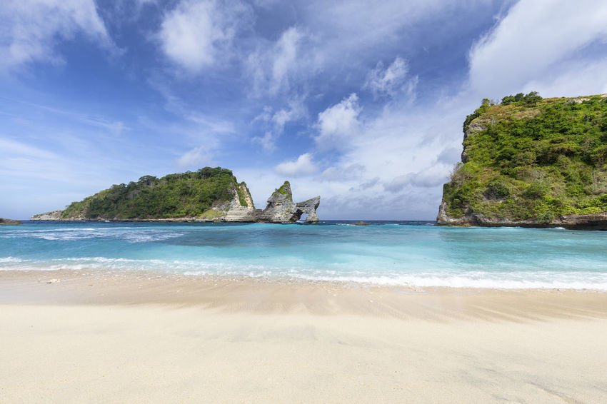 Empty Atuh Beach view near Bali, Indonesia. ASIA Atuh Beach Bali Diving INDONESIA Indonesian Snorkeling Travel Trip Adventure Atuh Balinese Beach Destination Geology Klungkung Nusa Penida Pejukutan Raja Lima Sea Arch Southeast Swim Tour Tropical White Sand